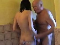Young brunette hair helps granddad take a shower and dries his cock with her throat