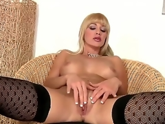Natalli DAngelo looks great in these dark stockings and matching heels. And I have to admit, shes got some moves on her, too. The kind only a MILF can possess. So hot.