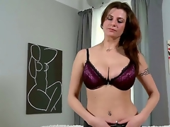 Lengthy haired attractive brunette milf Angie in sexy underwear gets naked on living room and reveals her huge breathtaking hooters and awesome tattoos in arousing teasing session