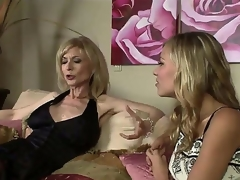 The luxurious milf pornstar Nina Hartley adores young girls and when this babe sees this pretty college bimbo Nicole Ray this babe decides to seduce her in any possible way