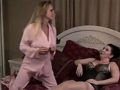 Golden haired momma Dyanna Lauren and her sexy darksome haired breasty friend RayVeness get really dirty when the guests go home and enjoy in their lesbian session in the bedroom.