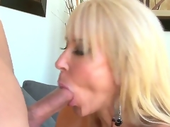 Provocative cock hungry experienced aged blonde wench Erica Lauren with big tits and amazing oral skills gets turned on and enjoys satisfying young muscled chap with unyielding cock