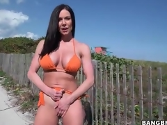 Hot milf Kendra Lust in orange bikini outdoors