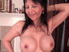 Hot mature caresses her big fake tits lustily