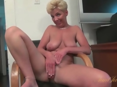 Breasty solo mature masturbates bald pussy