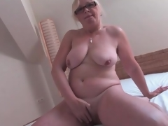 Naked old sweetheart masturbates her hairy cunt