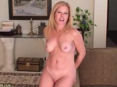 Glamorous blonde milf models her perky zeppelins for us